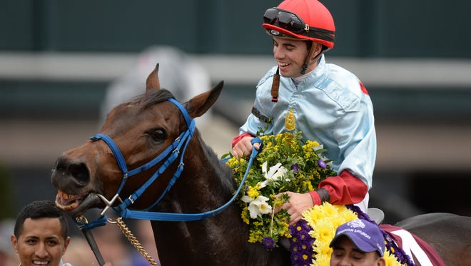 Mongolian Saturday with Florent Geroux wins the Turf Sprint during the Breeders' Cup World Championships at Keeneland Race Course in Lexington, Ky., on Saturday, October 31, 2015. Photo by Mike Weaver