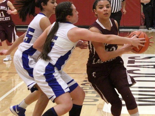 Tularosa's Cassie Vickery races down the court while