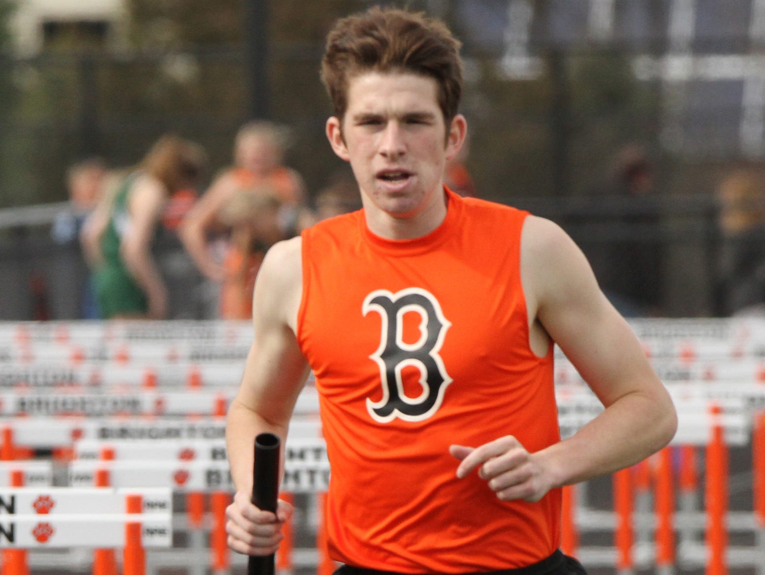 Brighton's Garrett McPeek completes the Brighton win in 3200 relay against Howell on Tuesday.