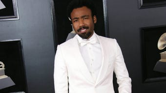 Donald Glover's musical colleagues answer questions about why the rapper/actor wasn't at the Grammy Awards. (Feb. 11)