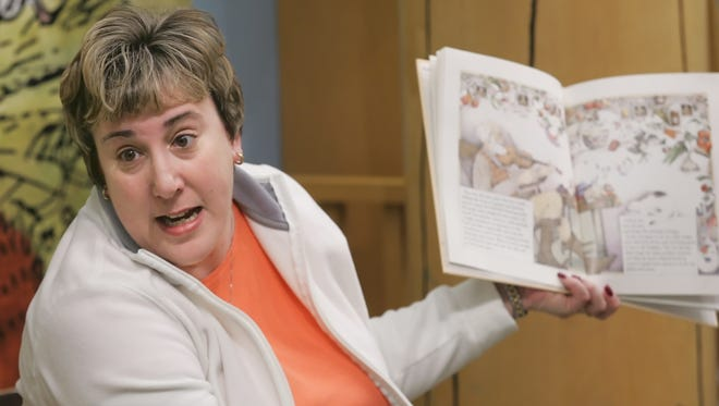 """In this file photo from 2010,, Krista Perdue reads from a book during the Subaru of Indiana Automotive, Inc. """"Drive"""" for TSC Book Fair. Perdue was reported missing Monday by her husband, Samuel Perdue."""