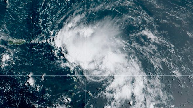 This satellite image released by the National Oceanic and Atmospheric Administration (NOAA) shows Tropical Storm Laura in the North Atlantic Ocean, Friday, Aug. 21, 2020. Laura formed Friday in the eastern Caribbean and forecasters said it poses a potential hurricane threat to Florida and the U.S. Gulf Coast. A second storm also may hit the U.S. after running into Mexico's Yucatan Peninsula.