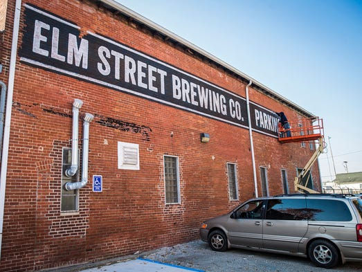 The owners of Elm Street Brewing Company and a group