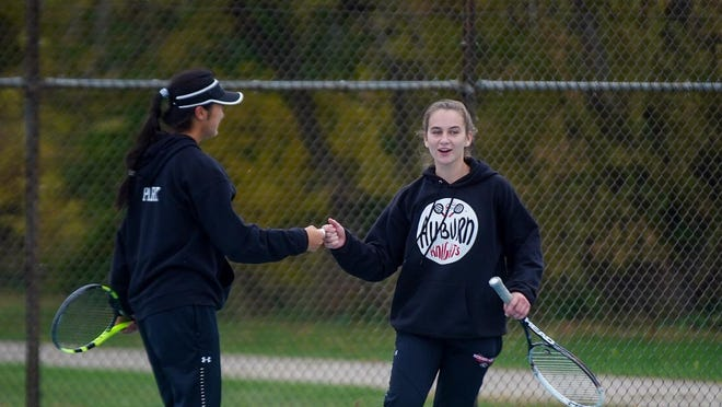 Auburn's Amy Park and Paris Thompson congratulate each other after winning a doubles sectional match Saturday at Harlem High School.