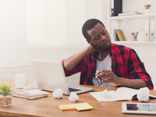 Overworked black businessman in casual office, work with laptop