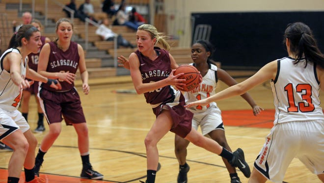 Scarsdale's Lindsay Kramer (30) goes up for two over the White Plains defense during girls basketball at White Plains High School on Jan. 14, 2015. Scarsdale defeated White Plains 49-30.