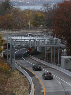 Cars travel under an electronic toll gantry on the entrance ramp to the New York State Thruway in South Nyack Nov. 13. Tolls for the Tappan Zee Bridge will be collected automatically when this gantry and another over the Thruway are put into use.