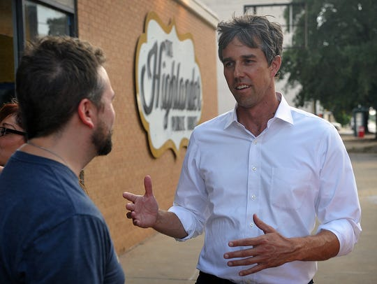 U. S. Congressman Beto O'Rourke talks with a supporter