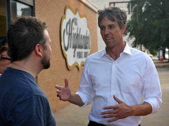 U. S. Congressman Beto O'Rourke talks with a supporter outside the Highlander Public House where a stand-room-only crowd heard about his campaign to run for the U.S. Senate seat of Republican Ted Cruz.