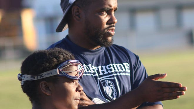 Northside lacrosse coach Chris Harris gives direction during a match in 2019. Harris has accepted an assistant coaching position at Chowan.