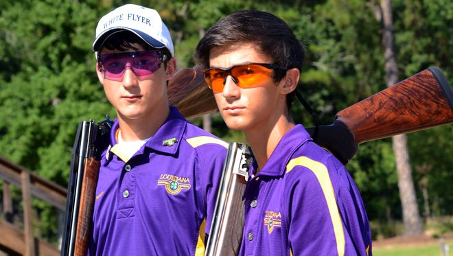 Colton Chandler (left), a 16-year-old junior at Grant High School, and Dylan Whitstine, a 15-year-old sophomore at Grant, competed recently on the national champion four-man Louisiana team at the National 4-H Shooting Sports Invitational in Nebraska. Whitstine finished second individually in the nation in clay shooting.