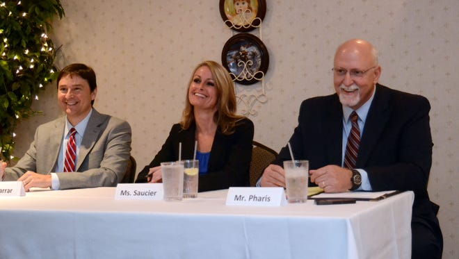Three candidates for Pineville City Court judge smile as they listen to a question during an Alexandria Exchange Club candidate forum Thursday. From left are Todd Farrar, Lauren Saucier and Fred Pharis. A fourth candidate, Gary Hays, was unable to attend because of a scheduling conflict.