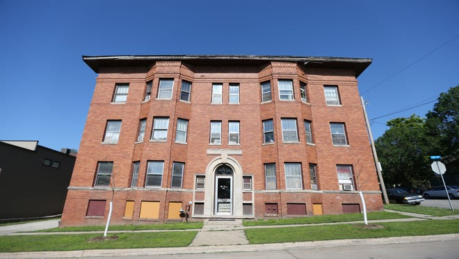A rare court order will vacate the Sherman Hill apartment complex, above, near downtown Des Moines.