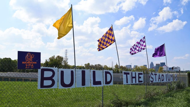 Signs hang along a fence near the Challenger Lift building which is for sale. Mayor Greg Fischer announced Sept. 22 the city will be using $30 million to help investors build a 10,000-seat soccer stadium in the Butchertown area. Louisville City FC will repay $14.5 million over 20 years from sales of land and stadium rent.