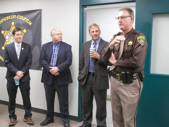 Livingston County Sheriff Mike Murphy, right, talks
