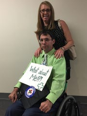 Eric Crawford, with his wife Michelle, showed up to support medical marijuana use at a hearing Wednesday in Frankfort.