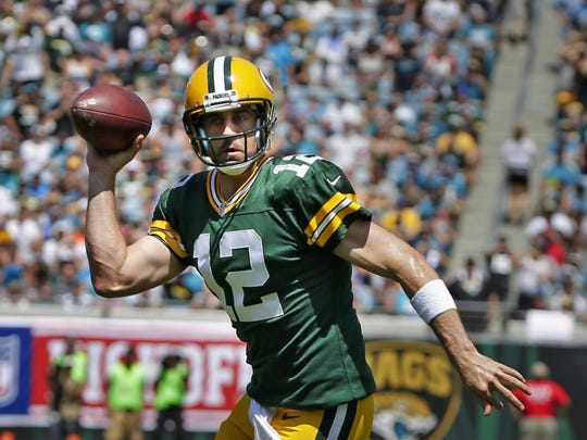 Green Bay Packers quarterback Aaron Rodgers scrambles for a touchdown in the first quarter while defended by Jacksonville Jaguars cornerback Davon House (31) during the season NFL football opener  between the Green Bay Packers and the Jacksonville Jaguars,  at Everbank Field,  Sunday, Sept. 11, 2016, in Jacksonville, Fla.