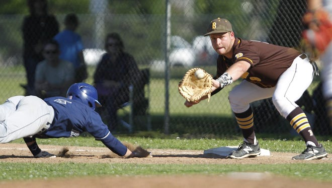 Redwood's Parker Cantrell gets back ahead of the throw as Golden West's Bryson Johnson moves to apply the tag in a West Yosemite League baseball game Thursday in Visalia.