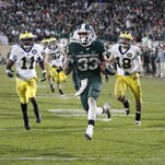 Michigan State's Jeremy Langford breaks away Nov. 2, 2013, in East Lansing. The Spartans cruised to a 29-6 victory.