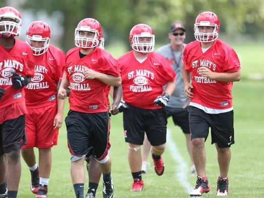 Orchard Lake St. Mary's football players go through