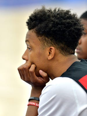 Romeo Langford watches the action between the Louisville Magic and the Twenty Two Vision, Friday, Jul. 21, 2017 in Louisville Ky.