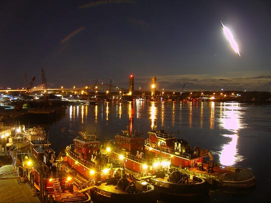 In this frame from video provided by Portsmouthwebcam.com, a fireball streaks across the sky at Portsmouth Harbor early Tuesday, May 17, 2016, in Portsmouth, N.H. The bright flash visible from several states was apparently left by a meteor burning up as it passed through Earth's atmosphere.