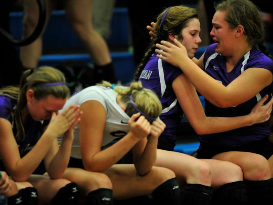 Father Ryan's Gracie Larkin, right, consoles Maggie Mullins on the bench after a 3-1 loss to Baylor during the Division II-AA Girls Volleyball Tournament at Siegel High School in Murfreesboro on Friday.