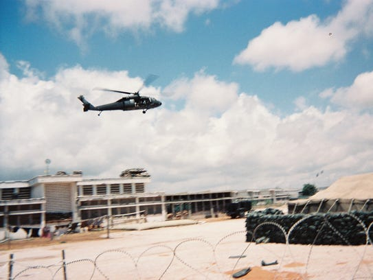 A U.S. Black Hawk helicopter flies into the U.N. compound
