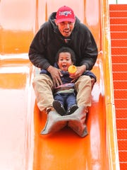 Eric Roebuck of Anderson rides with his son Eric Roebuck,