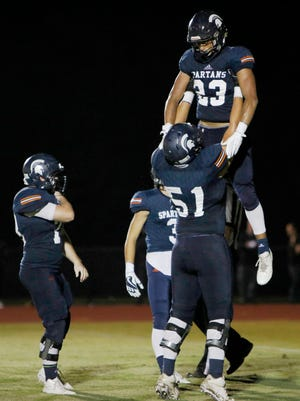 Summit running back George Odimegwu is hoisted after scoring against Columbia Central in the second half. Summit defeated Columbia Central 48-27.