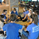 A youth group from All Saints Church in Dallas play cards during small group time at Steubenville South.