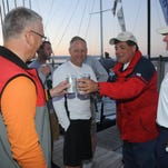 Win Cooper, Steve Bradley, Chris Benedict and Rick Birdsall toast to their first place finish the Port Huron-to-Mackinac Island Sailboat Race early Monday, July 20, 2015 at Mackinac Island Harbor.
