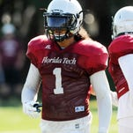 Florida Tech defensive back Manny Abad is congratulated by a teammate during Saturday's scrimmage in Melbourne.