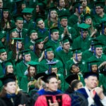 MSU faculty and staff applaud the remarks of the keynote speaker Susan B. Goldberg at the Fall 2015 MSU Commencement on Saturday, Dec. 19, 2015. The recent graduates have a better chance in the job market as hiring is expected to increase by 15 percent across all degree levels.