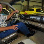 Mark Pieloch sits in a 1961 Pontiac Ventura Bubble Top with 421-cubic-inch motor earlier this month inside a Melbourne warehouse.