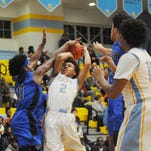 Clutch Dover holds off Cape hoops with defense