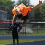 Port Huron Northern senior Michael Burrell practices his high jump in preparation for the AAU Junior Olympics on July 13, 2016.