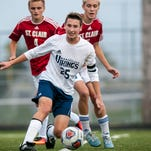 Marysville's Michael Booth attacks the ball during a soccer game Wednesday, Oct. 12, 2016 at Marysville High School.