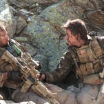 """Taylor Kitsch, left, and Mark Wahlberg are featured in """"Lone Survivor."""""""