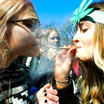 Participants smoke during the annual Hash Bash at the University of Michigan campus in Ann Arbor, Mich. on Saturday A statewide marijuana legalization ballot initiative is planned for 2016 that aims to allow residents to cultivate their own plants and allow other uses of the drug.
