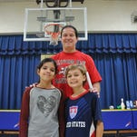 Physical Education teacher Len Saunders of Valley View Elementary School in Montville Township has created dozens of award-winning exercise programs for children. He is pictured here with fifth graders Chiara Lemee and Will Stozenski, who helped launch the 8 a.m. kick-off of the sixth annual Exercise US program.