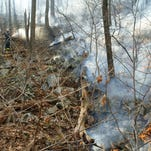 "Firefighters work to contain a brush fire off of Bailey's Gap Road in the Town of Marlborough in 2007. The National Weather Service has issued a fire watch, or ""red flag warning,"" for today from noon until 8 p.m."