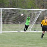 Indian River junior Brooke Beam tries to get a shot toward the Caesar Rodney goal, but it deflects harmlessly away.