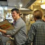 Zack Emery smiles after finding a vinyl record during a past Record Store Day at the Electric Fetus in downtown St. Cloud.