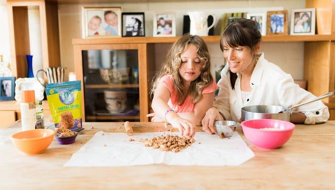 Goodie Girl Cookies creator Shira Berk makes Goodie Girl Cookies Rice Crispy Treat Energy Bars with her daughter, Meital.