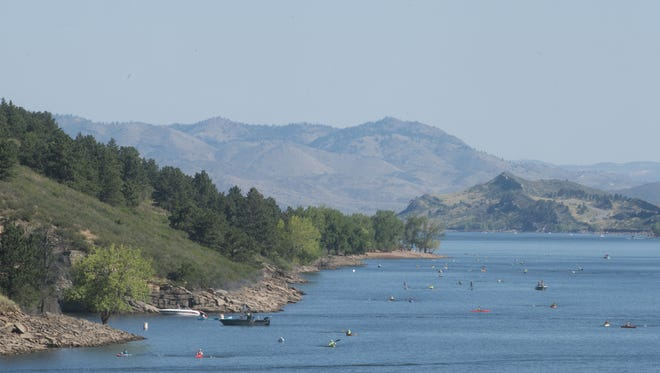 Swimmers in the Horsetooth Open Water Swim make their way down the reservoir Sunday, August 14, 2016.