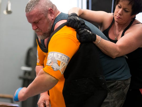 Michael Bowden of Mesa gets help from wife Cathy as he trains at Die Hard Gym and Fitness in Peoria for the Mr. Olympia power-lifting competition in Las Vegas.