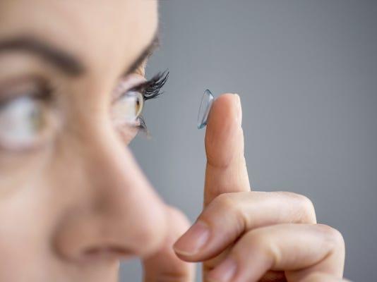 Staring at contact lens.jpg
