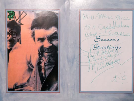 A holiday card written to Bill Bruton, showing Charles Manson with Geraldo Rivera, whose likeness Manson defaced, during an interview with Bruton a day after Charles Manson died after a long illness, Indianapolis, Monday 20, 2017. Manson spent 46 years in prison after he ordered several murders in California, including of the actor Sharon Tate.