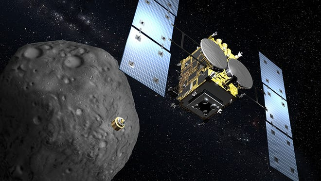 """This graphic illustration by Akihiro Ikeshita and received from Japan Aerospace Exploration Agency (JAXA) on September 2, shows Japan's space explorer """"Hayabusa-2"""" and an asteroid in space. JAXA will launch the Hayabusa-2 later this year to bring back samples of its targeted asteroid """"1999 JU3""""."""